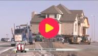Huis op vrachtwagen