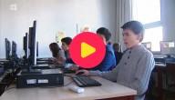 Jongens acher de computer